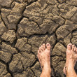 Naked Feet on dry Soil — Stock Photo