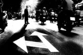 Solitary Man crossing the Road - Black and White dramatic Silhouette — Stock Photo