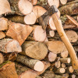 Axe stuck in a Stack of Wood — Stock Photo #32361329