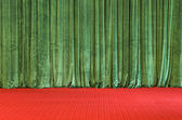 Green Curtains on a red Stage — Stock Photo