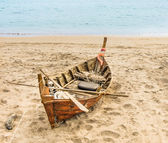 Old beached fishing Boat - Asian Style — Stock Photo