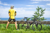Cyclist peeing in the bushes during a Race — Stock Photo
