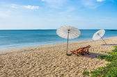 Deckchairs and Parasols on a solitary Beach — Stock Photo
