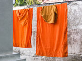 Washed and hung Clothes of buddhist Monks — Stock Photo