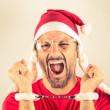 Portrait of a desperate young man with Santa Claus red hat — Stock Photo