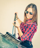 Young woman washing car with brush — Stock Photo