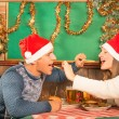 Young Couple flirting with american food at Christmas Dinner — Stock Photo