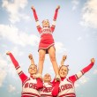 Cheerleaders team with male Coach — Stock Photo
