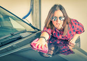Young beautiful woman cleaning her Car at Carwash — Stock Photo