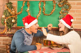 Young Couple flirting with american food at Christmas Dinner — Stockfoto