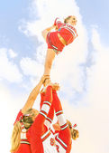 Young cheerleader balancing toward the Sky - Cheerleaders Team — Foto de Stock