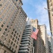 Stock Photo: AmericFlag at Wall Street - New York financial District