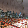 New York City - Manhattan Skyline from Brooklyn Bridge by Night — Stockfoto