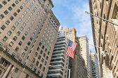 American Flag at Wall Street - New York financial District — Stock Photo