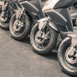 Stock Photo: Scooter wheels lined up