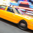 Yellow taxi speeding near Times Square in New York. — Stock Photo