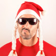 Puzzled man with Santa hat for Christmas — Stock Photo