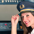 Stock Photo: Young female Pilot ready for Takeoff