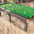 Vintage billiard - Pool table at the beach — Stock Photo