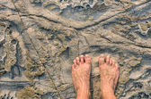 Human barefeet on a Stone background — Stock Photo