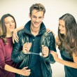 Stock Photo: Modern threesome Love - Two women with handcuffed Man