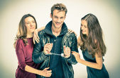 Modern threesome Love - Two women with handcuffed Man — Stock Photo