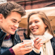 Young Couple lovely enjoying a cup of Coffee — Stock Photo #39155557