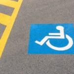Handicap road sign Parking spots — Stock Photo #39536339