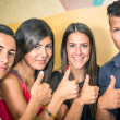 Happy group of friends with thumbs up — Stock Photo