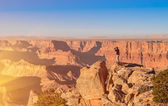 Adventurous man taking a photo at Grand Canyon before sunset — Stock Photo