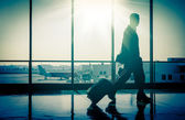Man at the Airport with Suitcase — Stock Photo