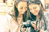 Young girls watching photos in a digital Camera — Stock Photo