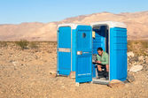 Man sitting in the Toilet in the middle of the desert - Death Va — Stock Photo