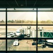 Modern airport with airplane at the terminal gate ready for takeoff — Stock Photo