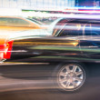 Speeding car and taxi cab in the night traffic of New York City — Stock Photo #42788513