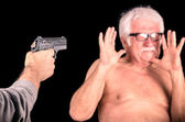 Criminal theratening scared old man with a Gun — Stock Photo
