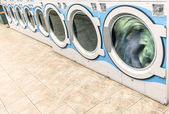 Industrial washing machines in a public Laundromat - Automatic Laundry — Stock Photo