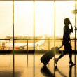 Business woman at Airport - Silhouette of a passenger — Stock Photo