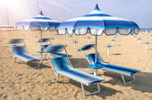Parasols and sunbeds at Rimini Beach - Italian Summer — Stock Photo