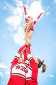 Cheerleaders team during Competition outdoors — Stock Photo
