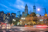 New York City traffic - Blurred lights at blue hour with Manhattan skyline in the background — Stock Photo