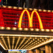 "NEW YORK - NOVEMBER 22, 2013. illuminated neon sign with the world famous ""M"" representing McDonalds along 42nd street in Times Square. The company was founded in 1940 in San Bernardino, California. — Stock Photo"