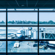 Modern airport with airplane at the terminal gate ready for takeoff — Stock Photo #45705811