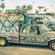 VENICE, UNITED STATES - DECEMBER 18, 2013: hippie artistic minivan on the Ocean Front Walk in Venice Beach. The image has been edited with a vintage retro nostalgic filtered look. — Stock Photo