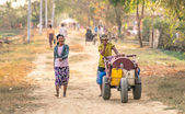 YANGON, MYANMAR - FEBRUARY 17, 2014: everyday life in a countryside village in the area of Dala. The Township consists of 23 wards and is bounded by the Yangon River in the north and east side. — Stock Photo