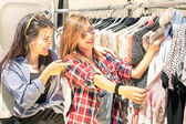 Young beautiful women at the weekly cloth market - Best friends sharing free time having fun and shopping in the old town in a sunny day — Stock Photo