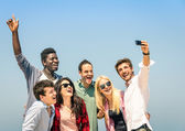 Group of multiracial friends taking a selfie on the blue sky - Concept of happiness and friendship all together against racism — Stock Photo