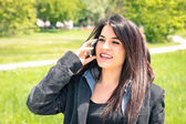 Young business woman in the park with smartphone having a break after a working day - Modern concept of nature mixed with new technology and metropolitan life — Foto de Stock