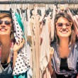 Young beautiful women at the weekly cloth market - Best friends sharing free time having fun and shopping in the old town in a sunny day - Girlfriends enjoying everyday life moments — Stock Photo #50208623