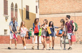 Group of happy best friends with shopping bags in the city center - Tourists walking and having fun in the summer around the old town - University students during a break in a sunny day — Foto Stock